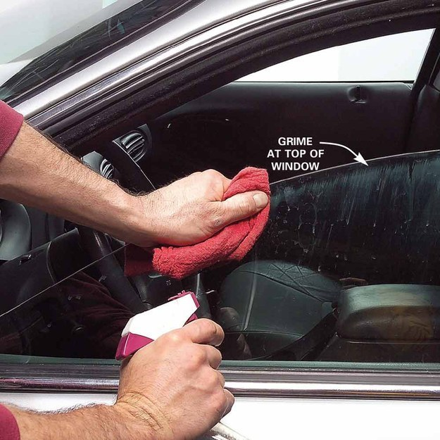Cleaning the grime off the top of a car's front passenger window