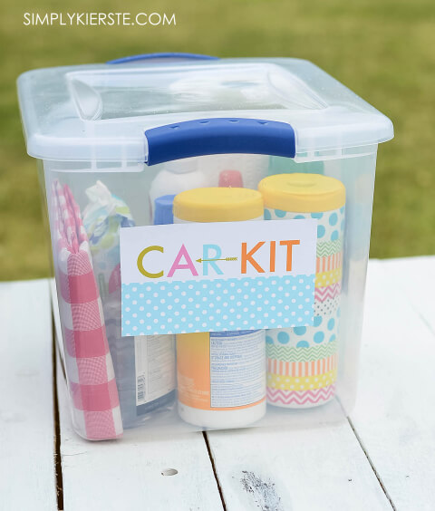 "A box labelled with the words ""Car Kit"" filled with car essentials"