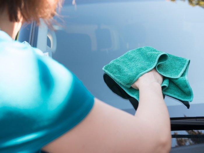 Cleaning the exterior windshield with a microfiber cloth