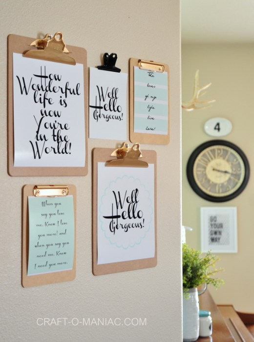 Clipboards nailed to the wall with printable word art on them.
