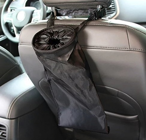 A specially designed attachable trashbag hanging off a car's front seat