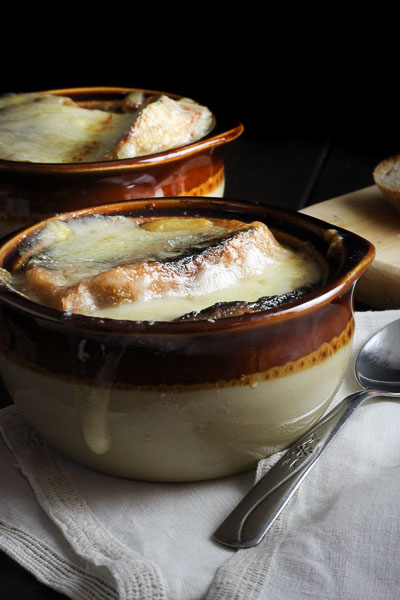 Classic French Onion Soup with caramelized onions & melted french cheese. Comfort Soup at its finest!