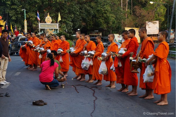 giving alms monks thailand