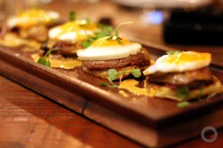 Seared foie gras pancakes marinated foie, johnny cakes, duck ham, duck eggs, bourbon maple, hot sauce hollandaise
