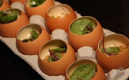 Hen egg emulsion With black garlic, basil and crispy chicken skin