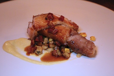 One of the best pork chops I've ever had with spaetzele, corn, fava beans, smoky bacon jus
