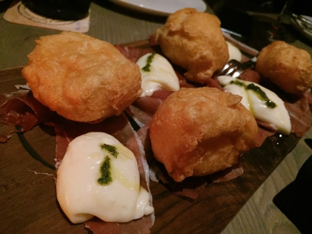 Coccoli – crispy dough, stracchino cheese, prosciutto di Parma, truffle honey