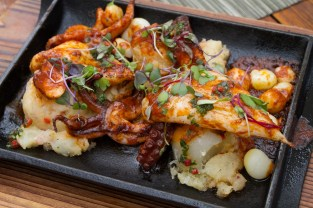 Plancha Anticuchero – grilled octopus, calamari, crushed potatoes, ají panca pepper sauce, chimichurrie, choclo corn