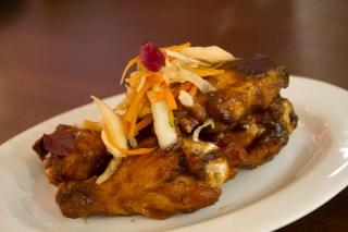 Jerk Chicken Wings, smoked over allspice leaves, pickliz
