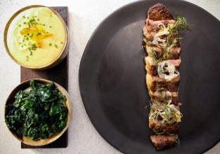 Charcoal Strip Loin – creamed greens, pureed potato, smoked vidalia, brown butter soy