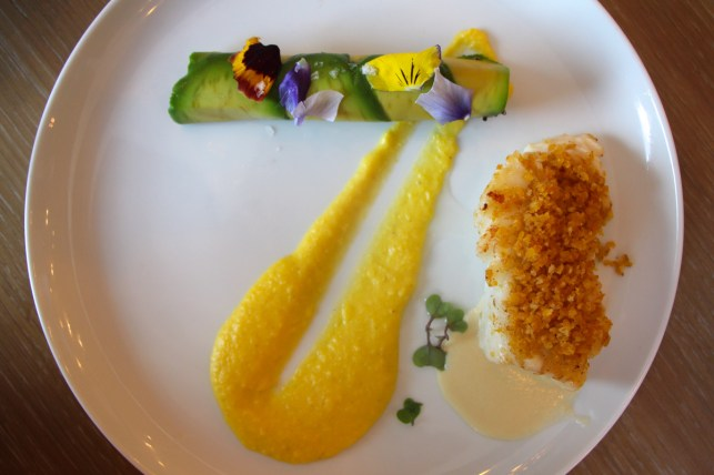Plantain Crusted Pacific Sea Bass was served with a side of award-winning avocado quinoa cannelon along with a corn puree and citrus sauce.