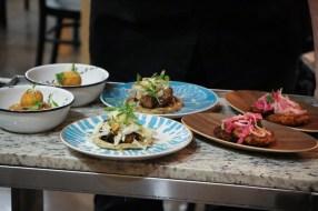 (Middle) Gordita – Haitian Griots & Pikliz, cotija, raw vegan verde