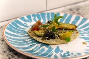 Vegan Fried Avocado – Pickled fresno chili, heirloom tomato, sunflower seed, hemp seed