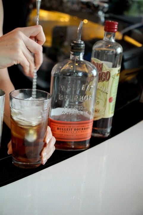 Bulleit Bourbon, Tempus Fugit Crème de Cacao, orange bitters, angostura bitters