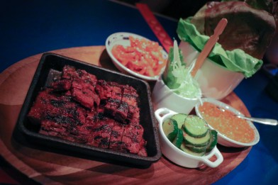 Lettuce Wraps made with Korean BBQ Skirt Steak, traditional pickles and garnishes