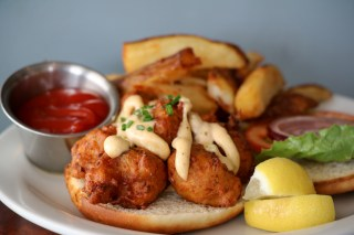 Conch Fritters Po' Boy with spicy tartar sauce