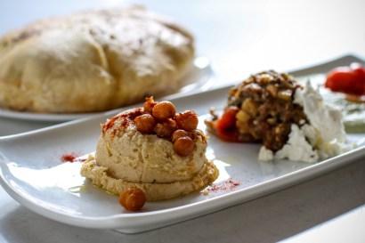 Apeiro Spread Platter with hummus, eggplant caponata, pistachio yogurt, and freshly made house baked pita