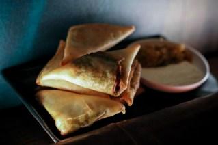 Samosas with sweet peas, Kaffir lime yogurt, and a golden raising chutney