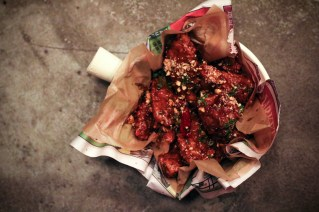 Kung Pao Chicken Wings with peanuts, buttermilk ranch and chilies.