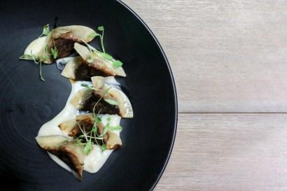 Filet & Foie Dumpling with sunchoke puree and port sherry vinaigrette