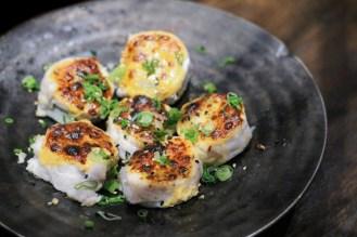 Classic – tuna, yellowtail, wrapped with seasonal white fish, scallion, scallion, spicy sauce, eel sauce, baked