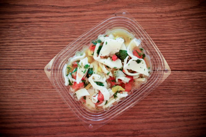 Young Thai coconut meat ceviche w/ tomato, onion, peppers, lime, cilantro, passion fruit, sesame oil, sea salt