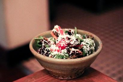 House Salad – brassica greens, shaved seasonal vegetables, ricotta salata, cucumber-oregano vinaigrette