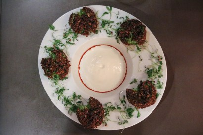 Falafel with aerated yogurt, fava shoots and paprika oil