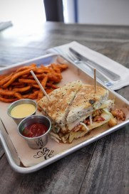 Lobster Reuben - An entire Maine lobster topped with gruyere cheese, our homemade cole slaw and LoKal sauce, served on a toasted crust-free rye bread.