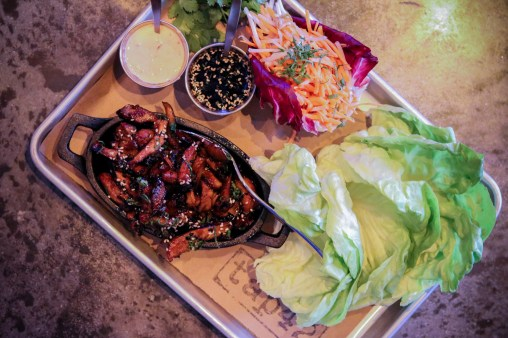Korean Chicken Lettuce Wraps filled with Shiitakes, Bean Sprouts, Cilantro and a Chili Soy Vinaigrette