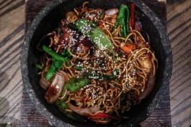 TALLARIN TAYPA - pan fried egg noodle, XO, crab meat, tofu, char siu, quail eggs, onions, snow peas, soy sauce