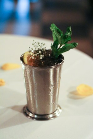 Harlem Sunset filled with Maker's Mark® 46, Pineapple, Lime Juice, Orgeat, House Apple Bitters, Angostura, Mint and Sage