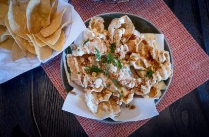 Chicharrones topped with salsa borracha and roasted garlic mayo