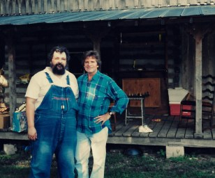 Tony (L) with John Fogerty, 1990