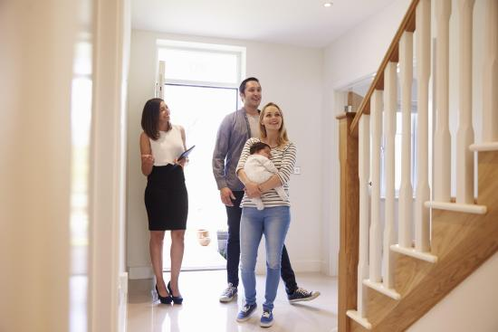 a family with real estate agent inside the house | Chattanooga Home Inspector | buying a home Chattanooga