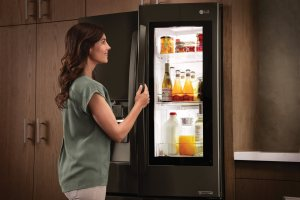 A woman opening a fridge | Chattanooga Home Inspector | kitchen Chattanooga