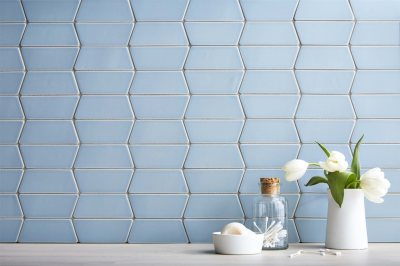 white flowers, soapdish, and a bottle in a tile wall | Chattanooga Home Inspector | Tile Chattanooga