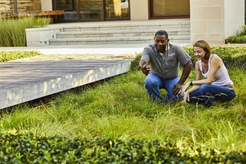 landscape contractor and homeowner in the lawn | Chattanooga Home Inspector | landscape professional Chattanooga