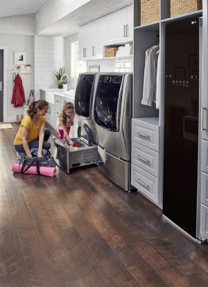 mother and child doing laundry | Chattanooga Home Inspector | Household routine Chattanooga