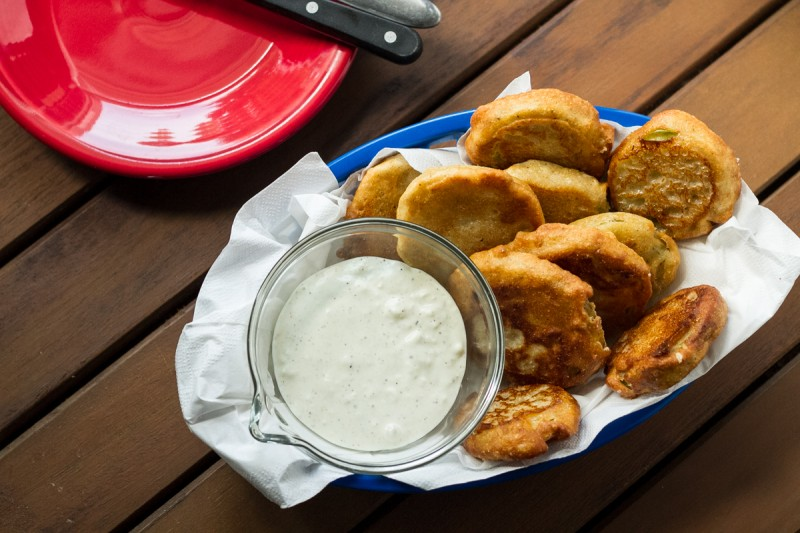 Southern fried green tomatoes are a summertime classic! They're perfect served with Alabama white barbecue sauce for dipping. | recipe from Chattavore.com