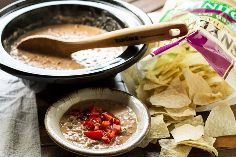 Slow cooker chili cheese dip is so easy to make and it's sure to be a crowd pleaser. The ingredients are simple and it's super tasty! | recipe from Chattavore.com