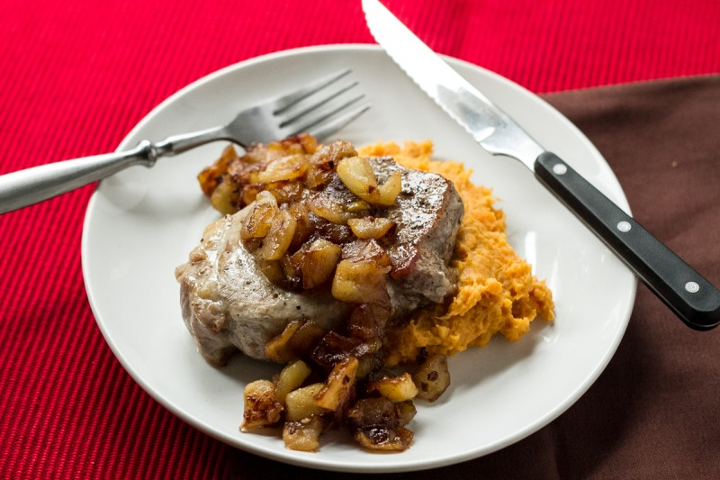 With sweet potatoes to complete the ensemble, these pork chops with fried apples and ginger are fall on a plate, and it's a super-simple meal to make! | recipe from Chattavore.com