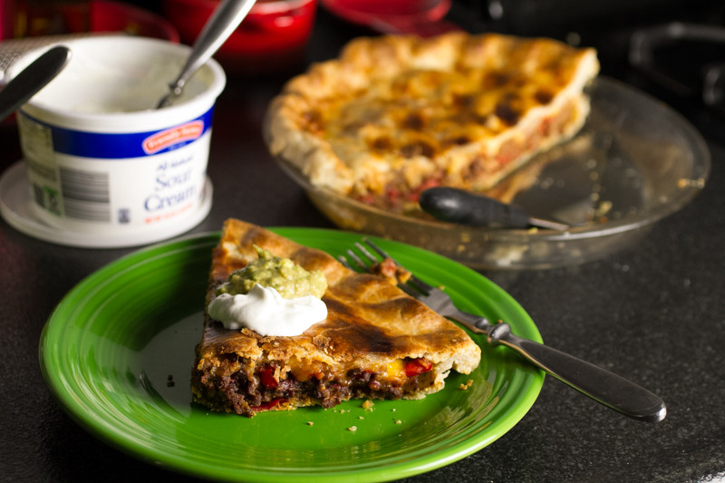 If you love tacos, you'll love taco pot pie. It's everything you'd eat in a taco stuffed into a buttery pie crust and baked up till golden! | recipe from Chattavore.com