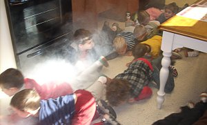 Children learn to crawl beneath the smoke and heat