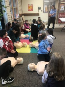 Students practicing CPR on mannequins
