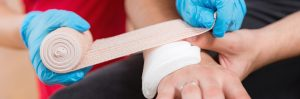 Treating a wound with gauze and bandage