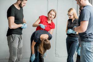 Instructor teaching Heimlich's Maneuver