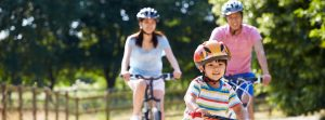 Child biking safely with adults