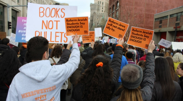 Reform Jewish teens seen from behind at gun violence prevention march