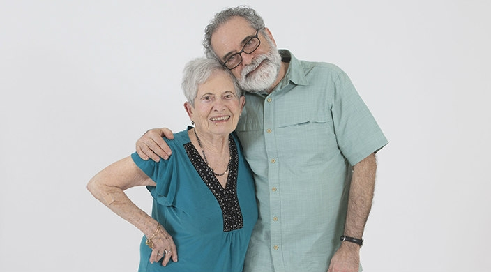 The author and his elderly mother posing together against a white background